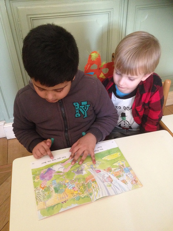 Two boys learning to read.