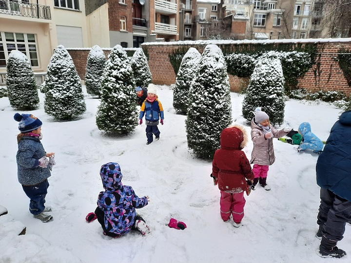 Children playing outside in the snow.